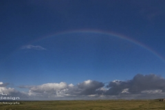 Sylt Leuchtturm List Ost mit Regenbogen